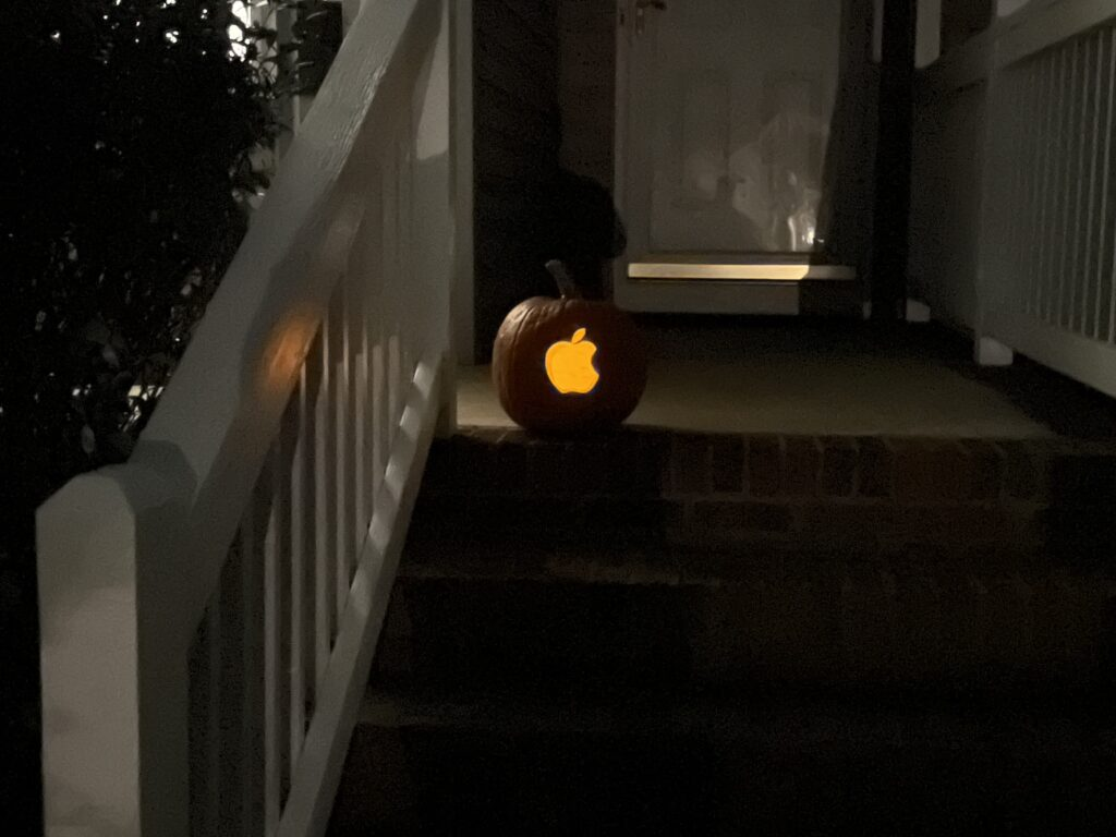 A pumpkin with the Apple logo carved in it.